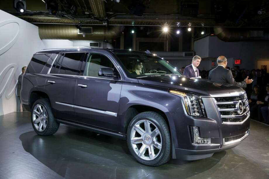 Senior Vice President Global Cadillac Bob Ferguson (left) and General Motors Vice President Global Design Ed Welburn unveil the 2015 Cadillac Escalade Monday, October 7, 2013 in New York, New York. The fourth-generation Escalade offers an entirely new design featuring new benchmarks for hand-tailored craftsmanship and technology. Production of the 2015 Escalade begins next spring with 2WD and 4WD drivetrains, and a new more powerful and more efficient 6.2L V-8 engine. (Cadillac News Photo) Photo: Cadillac News Photo
