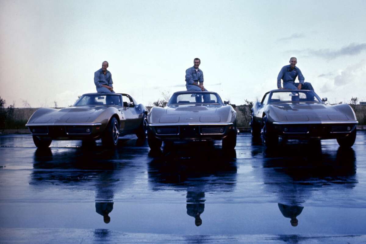 Apollo 12 astronauts (L-R) Charles 'Pete' Conrad Jr., Richard Francis Gordon Jr., and Alan LaVern Bean with their identical 1969 Corvette Stingray coupes. The coupes features a 390-hp, 427 V-8 and black-accented Riverside Gold color scheme designed by Bean. Photo by Ralph Morse / Time & Life Pictures / Getty Images.