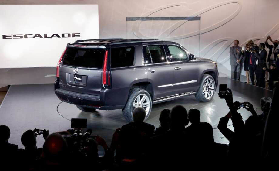 The 2015 Cadillac Escalade makes its world debut Monday, October 7, 2013 in New York, New York. The fourth-generation Escalade offers an entirely new design featuring new benchmarks for hand-tailored craftsmanship and technology. Production of the 2015 Escalade begins next spring with 2WD and 4WD drivetrains, and a new more powerful and more efficient 6.2L V-8 engine. (Cadillac News Photo) Photo: Cadillac News Photo
