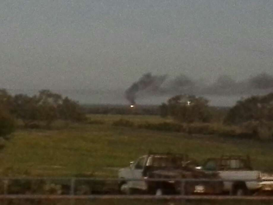 Fire and smoke is visible along a stretch of U.S. 80, south of Stockdale. Photo: Courtesy