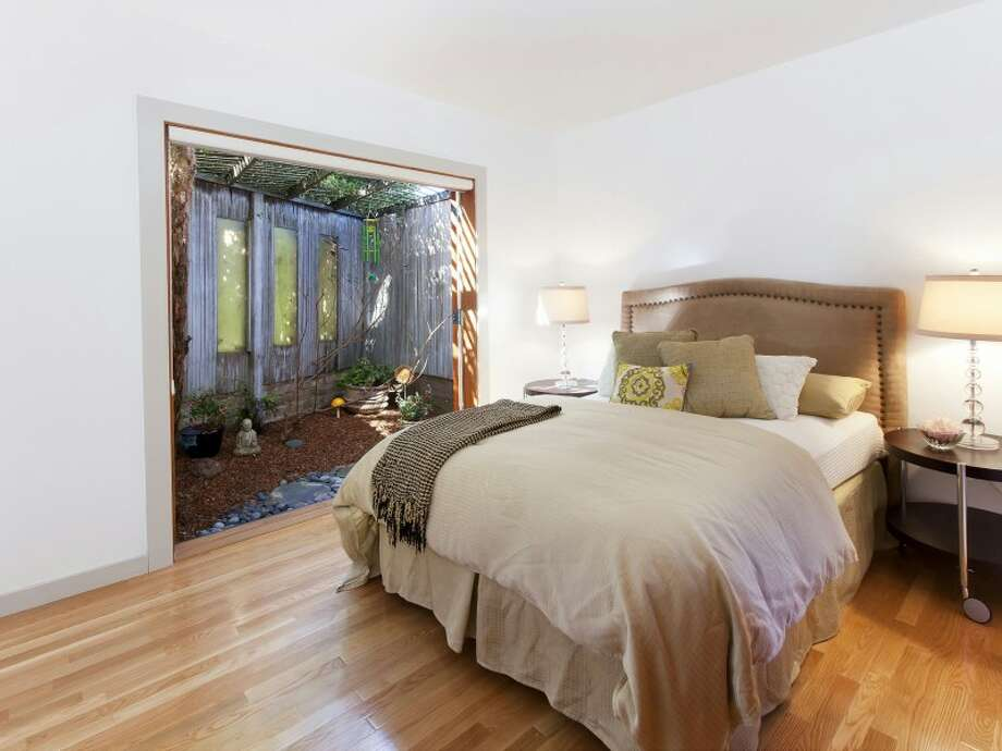 Bedroom with glass wall effect. Photos   via Paul Ybarbo/Sotheby's