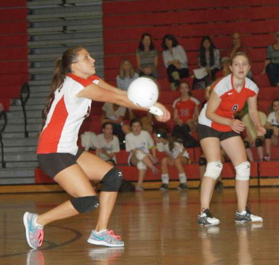 Tori Gallati, left, returns the ball for Fairfield Warde with teammate Stephanie Sheehan in position during the Mustangs' 3-0 FCIAC girls volleyball victory over Bassick on Monday, Oct. 7 in the Mustangs' gym. Photo: Andy Hutchinson / Fairfield Citizen