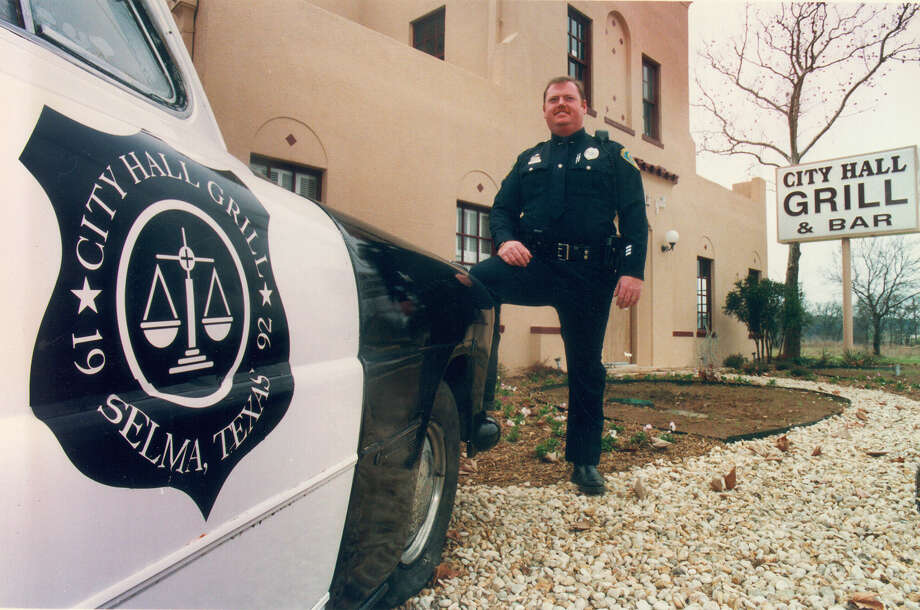 Selma, just north of San Antonio, is a notorious speed trap. This 1993 file photo shows Selma police officer Tony Garland standing by a 1950 Hudson patrol car, outside the City Hall Grill, which used to the actual City Hall. It operated from 1993-99, using Selma's 'speed trap' reputation as a marketing strategy. It's now a Hooter's restaurant, but the speed trap remains. Photo: RICK HUNTER, FILE / SAN ANTONIO EXPRESS-NEWS