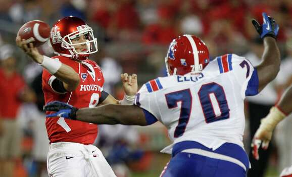 Houston quarterback David Piland (8) is pressured by Louisiana Tech defensive lineman Justin Ellis (70) as he throws a pass during the fourth quarter of an NCAA football game at Robertson Stadium, Saturday, Sept. 8, 2012, in Houston. Louisiana Tech beat Houston 56-49. Photo: Brett Coomer, Houston Chronicle / © 2012  Houston Chronicle