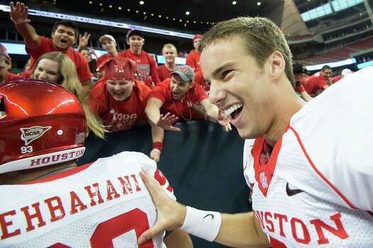 Houston quarterback David Piland celebrates with fans after the Cougars defeated crosstown rival Rice in a college football game at Reliant Stadium, Saturday, Sept. 29, 2012, in Houston. Photo: Smiley N. Pool, Houston Chronicle / © 2012  Houston Chronicle
