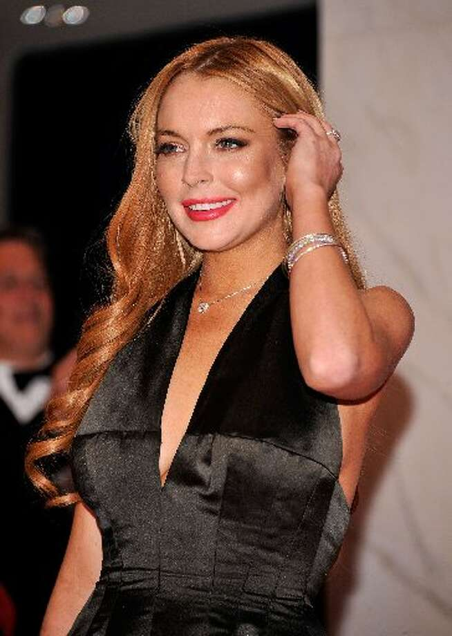 "Following her Playboy shoot, Lohan starred in two critically-panned films: ""Liz & Dick"" and ""Canyons"". She later pleaded no contest to reckless driving and was sentenced to community service and rehab."