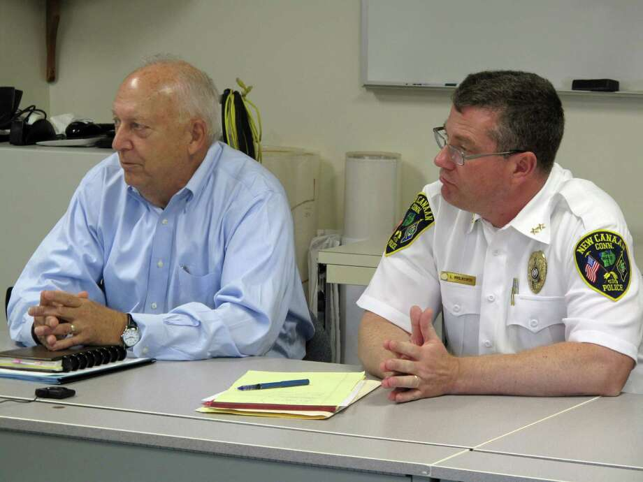 Police Commission Chairman Jim Cole (left) and Police Chief Leon Krolikowski (right) listen to comments and answer questions from the Board of Selectmen on Tuesday morning, Oct. 8, 2013. New Canaan, Conn. Photo: Tyler Woods