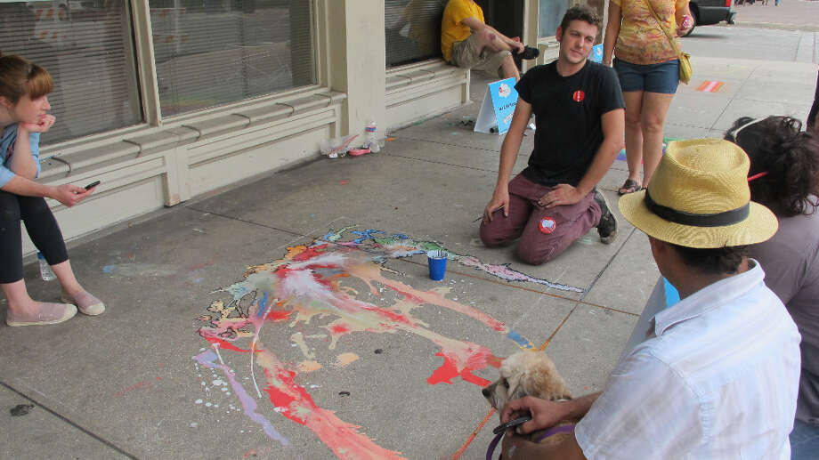 Aldon Mines discusses his piece with people attending Chalk It Up 2012.