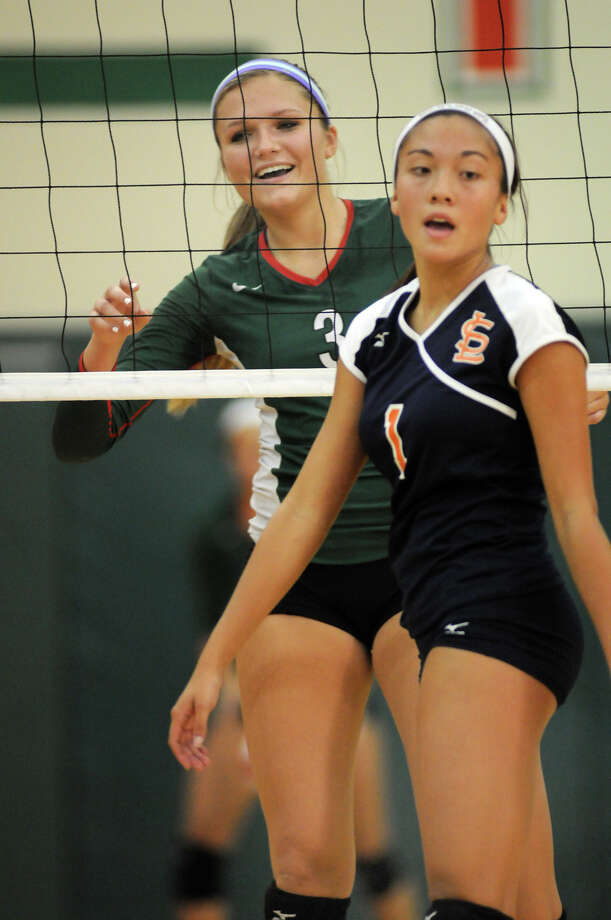 Seven Lakes setter Sami Hauck, right, and the Spartans need a win against Katy Taylor to keep pace in the playoff hunt.