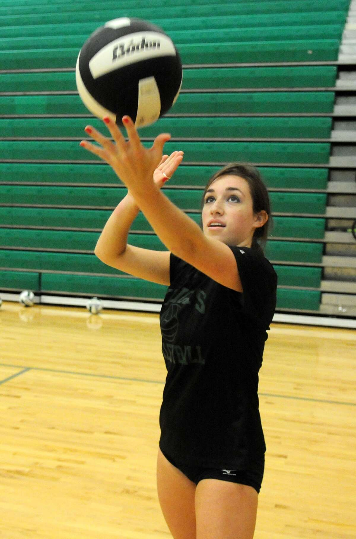 Clear Falls senior libero Morgan St. Germain perfects her serving technique during a recent practice.