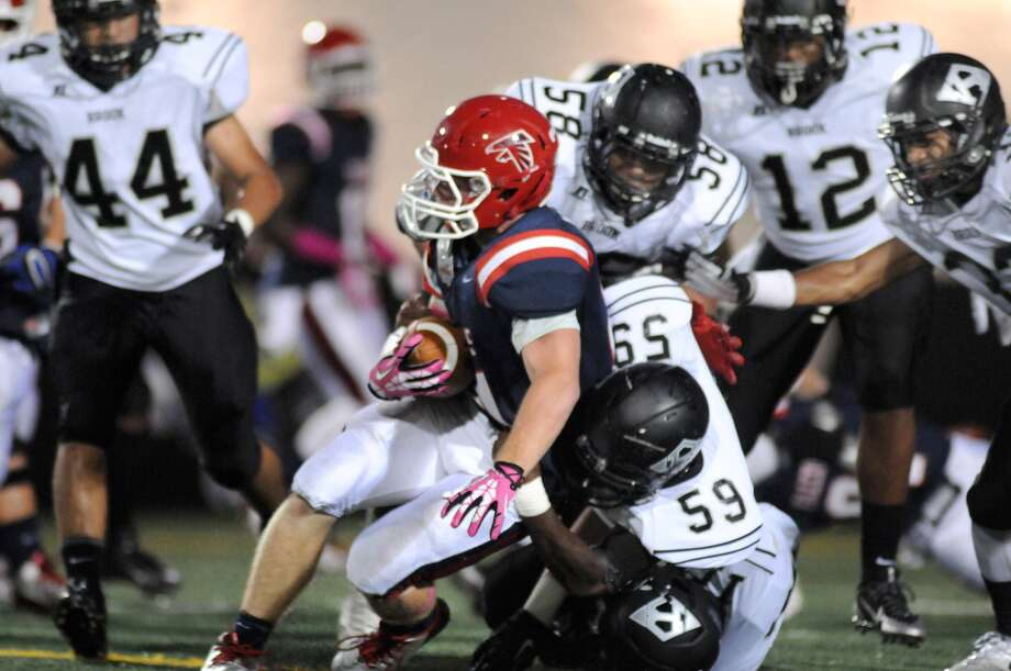 Clear Lake junior running back Nicholas McGee, left, gets wrapped up by Clear Brook's Kenneth Malone (58) and Kameron Dolford (59). Photo: Jerry Baker, Freelance