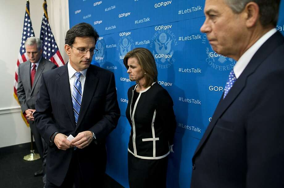 Republican leaders Reps. Kevin McCarthy of Bakersfield (left), Eric Cantor of Virginia, Lynn Jenkins of Kansas and Speaker John Boehner discuss the GOP position on a debt default. Photo: Evan Vucci, Associated Press