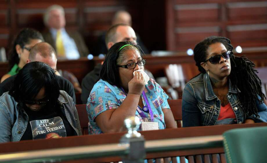 Takim Smith's grandmother Joan Bell, center, reacts to the plea that was taken Tuesday, Oct. 8, 2013, by Eric Aaron Mallard for the killing of Takim Smith earlier this year in Troy, N.Y.     (Skip Dickstein/Times Union) Photo: SKIP DICKSTEIN / 00024164A