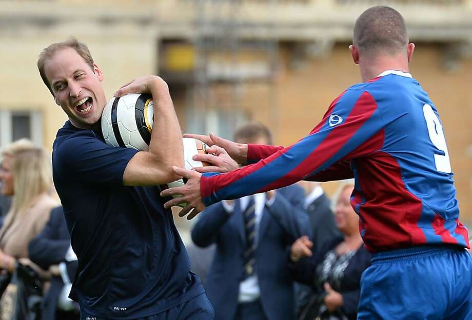 Excellent rugby technique, Your Highness! However, as this is football ...Prince William trains with players on 