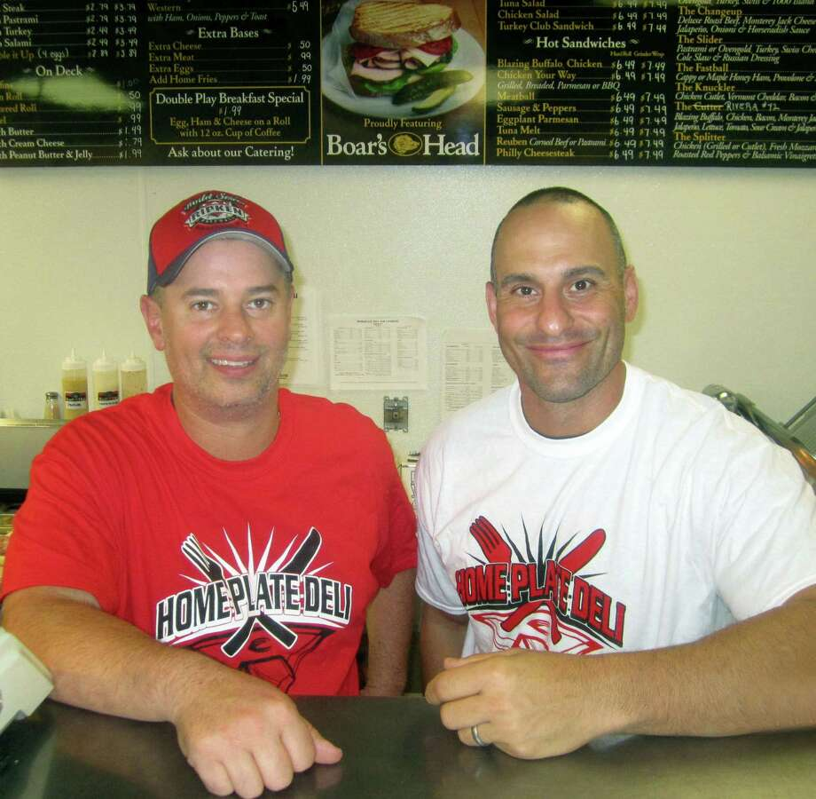 Paul Gesualdi, left, and Lance Pliego are co-owners of the Home Plate Deli, located at the northeast corner of the intersection of Danbury Road (Route 7 South) and Sunnday Valley Road. October 2013 Photo: Norm Cummings