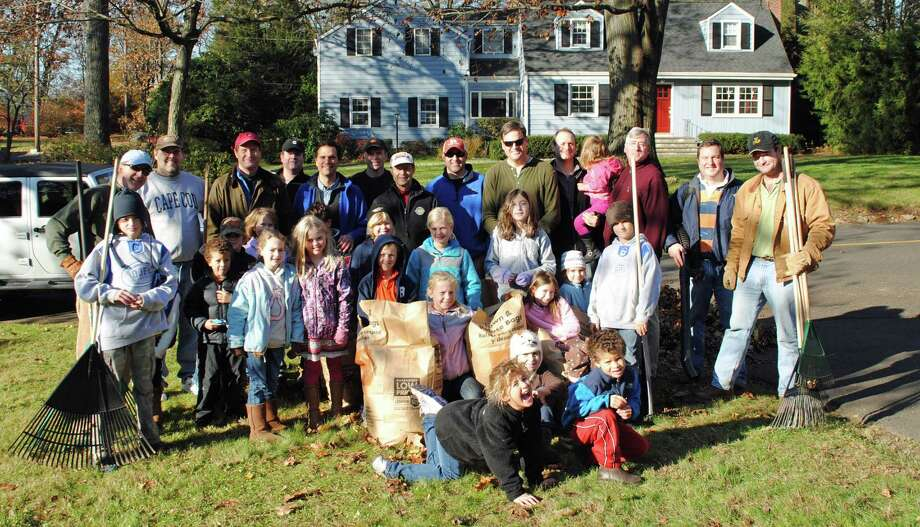 Seniors who are interested in having their leaves raked should contact At Home in Darien at 203-585-4094 as members are coordinating community volunteers for the fall leaf raking program. Pictured are last yearís leaf rakers from the Darien Y Guides and Princesses. Photo: Contributed Photo