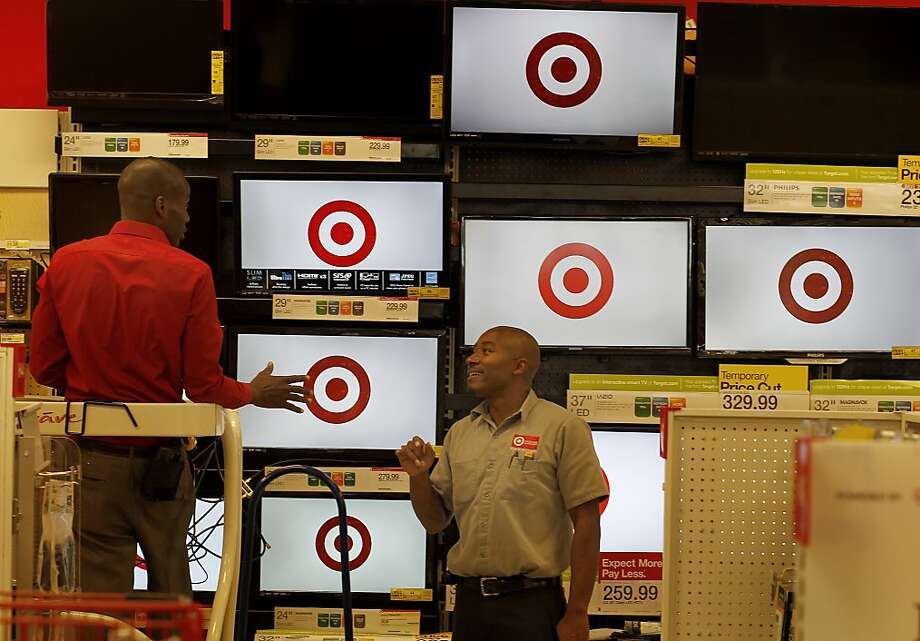 Workers get the televisions running Monday in the electronics area of the new CityTarget, opening Wednesday. Photo: Brant Ward, The Chronicle