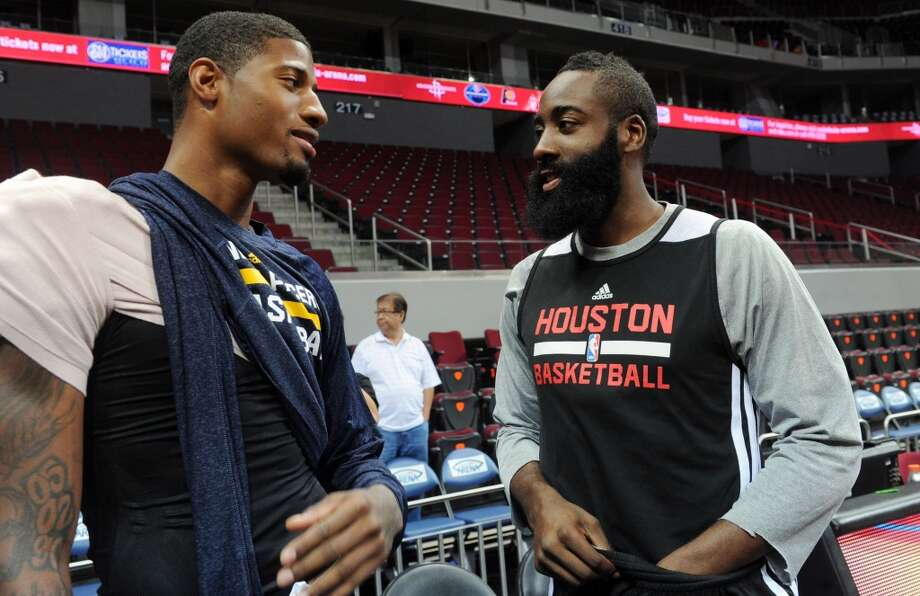 James Harden talks with Indiana Pacers forward Paul George on Tuesday. Photo: Jay Directo, AFP/Getty Images