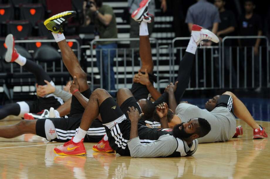 James Harden (front) looks on as he stretches with teammates during practice on Tuesday. Photo: Jay Directo, AFP/Getty Images