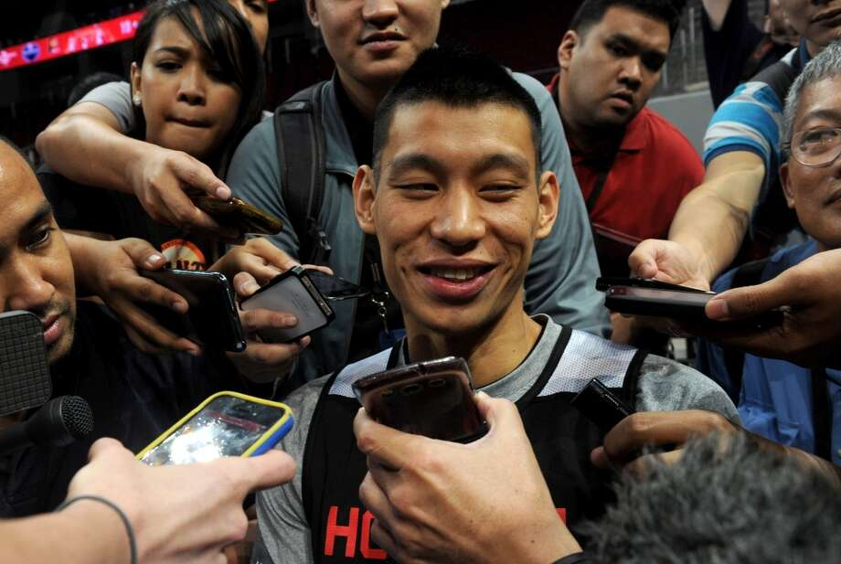 Jeremy Lin talks to reporters after practice on Tuesday. Photo: Jay Directo, AFP/Getty Images