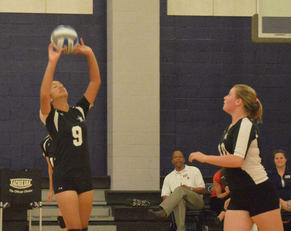 Number 9 for St. John's, Monica Dayao sets the ball up vs Emory.