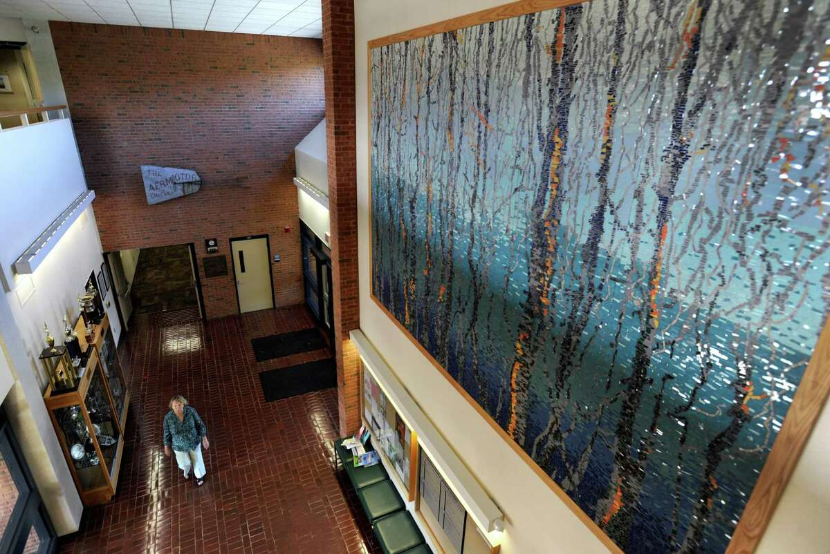 """""""Reflections in Mosaic"""", a 150-square-foot, Monet-type mural, was unveiled at the Brookfield Town Hall Sunday, Oct. 6 at the Brookfield Days 225th anniversary celebration. A project of the Brookfield Arts Commission and Friends of the Arts, the mosaic mural was funded through a combination of state economic development and National Endowment of Arts grants, with matching donations. The design is the creation of local artists, Joanne and Bruce Hunter, who also designed the iconic horse sculptures in the front of the Municipal Center entrance."""