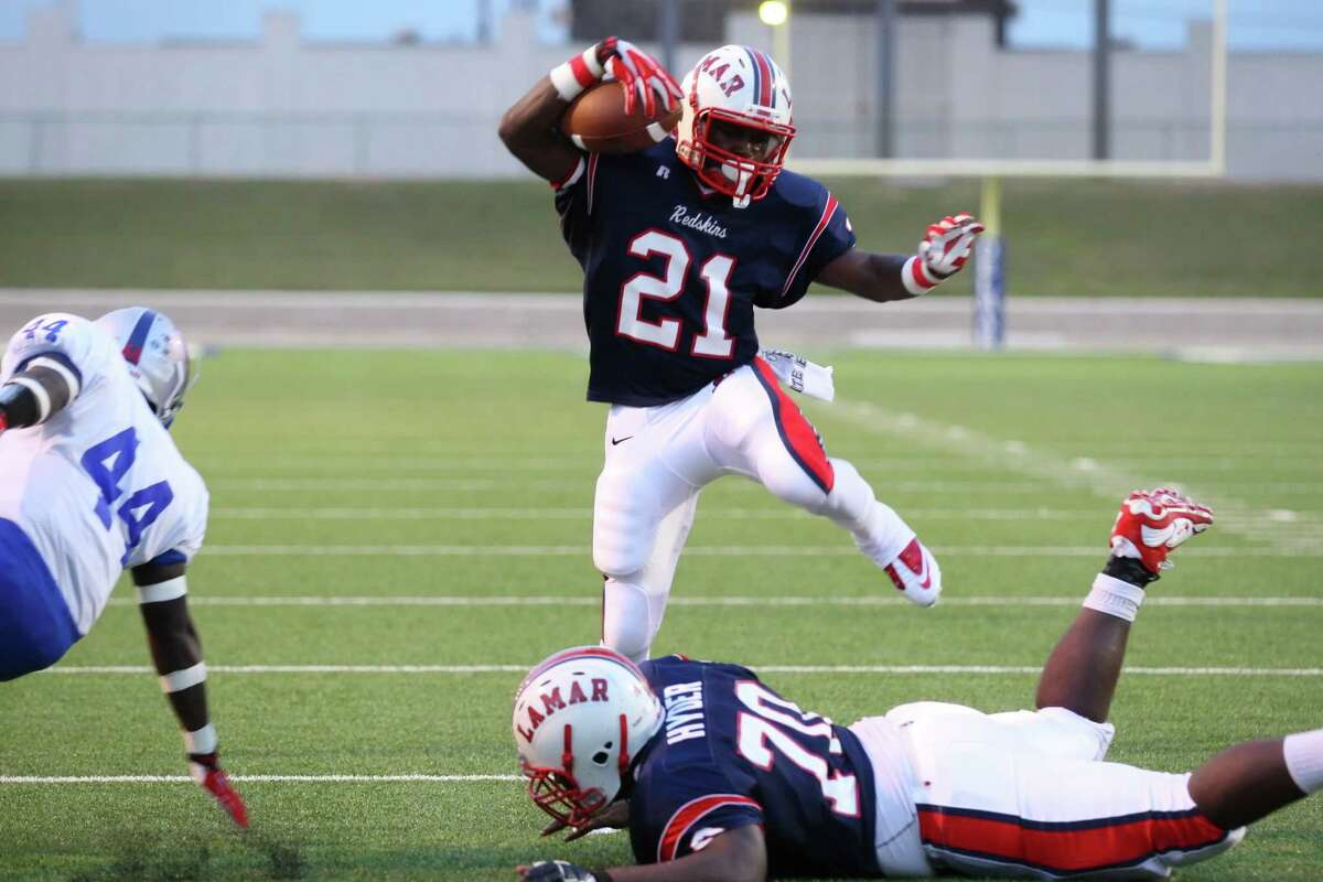 Lamar running back Ronnie Wesley steps over his teammate Braylon Hyder as he makes a first down run during the Westbury game Friday.