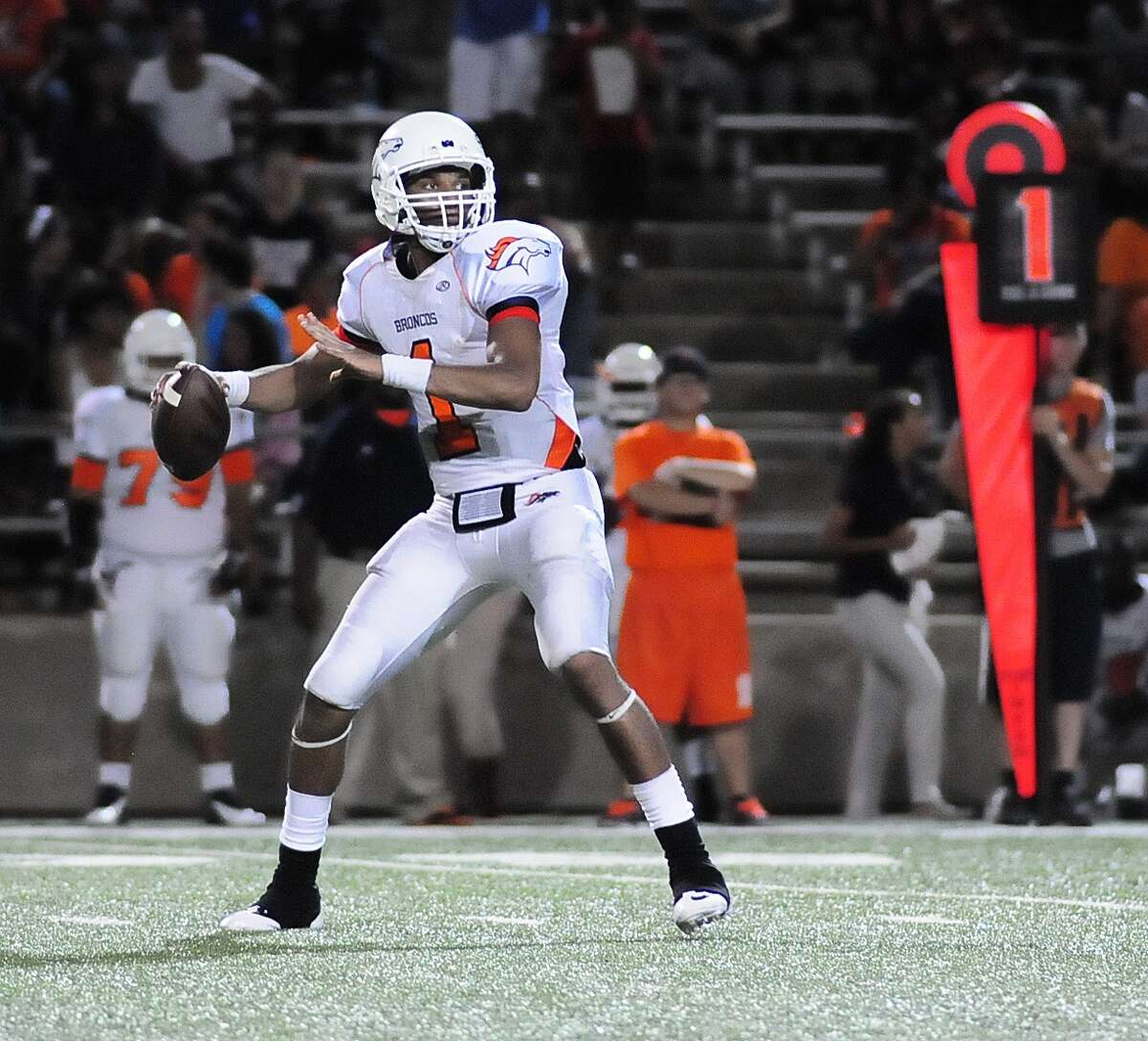 Bush quarterback Ronald Monroe (#1) looks for a receiver during their game with Travis at Mercer Stadium Friday 10/04/13.