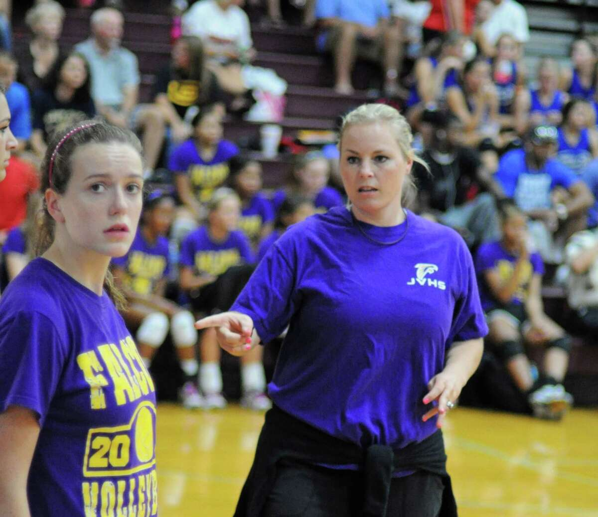 Jersey Village volleyball coach Carrie Schneider (right) during a scrimmage on 8-11-12 at Magnolia.