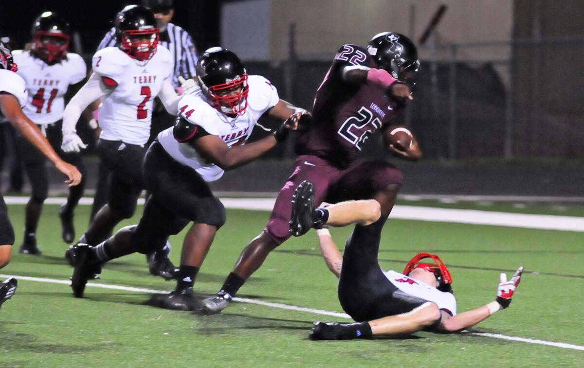 George Ranch running back Collins Kwabena (cq) (#22) scores a touchdown after running through Terry defensive back Neilson Williams (cq) (#7) (on the ground) and defensive lineman Roderick Jones (#44) during the second half of their game with Terry at Traylor Stadium in Rosenberg Friday 10/04/13.