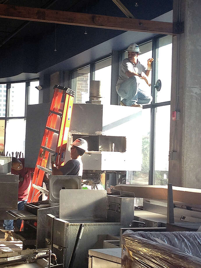The build-out for Trenza included removing Alto's pizza oven through a window. (Photo: Trenza)