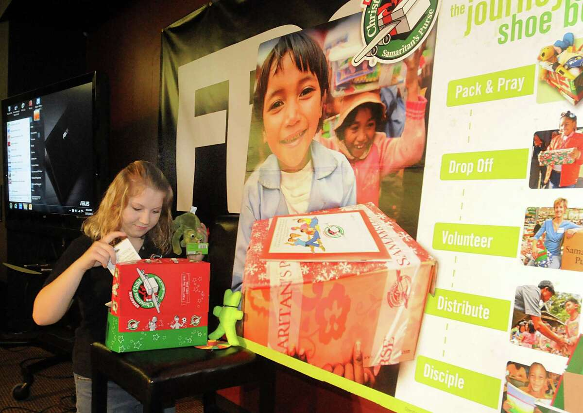 Tatiana Woods fills a shoebox with small gifts for Operation Christmas Child, at Faith Bible Church, 5505 Research Forest Drive in The Woodlands. Tatiana is a spokesperson for Operation Christmas Child program in Texas and Louisiana. She received a Operation Christmas Child box when she was an orphan in Russia.