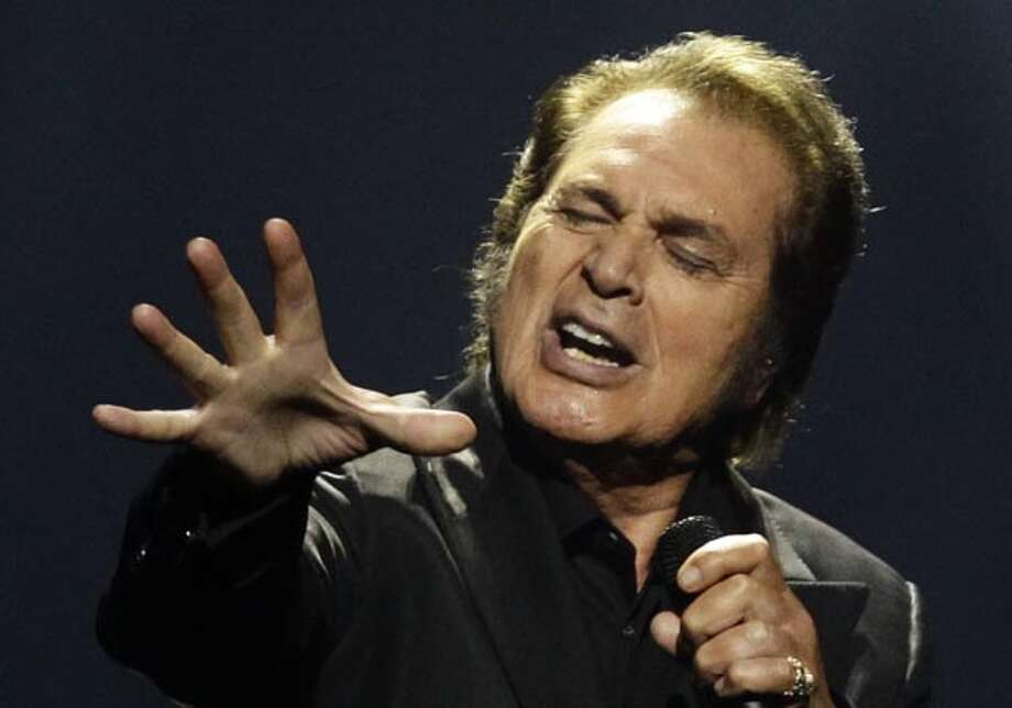 File - In this May 27, 2012 file photo United Kingdom's Engelbert Humperdinck performs during the final show of the 2012 Eurovision Song Contest in Baku, Azerbaijan. (AP Photo/Sergey Ponomarev, File) Photo: Sergey Ponomarev, AP / AP