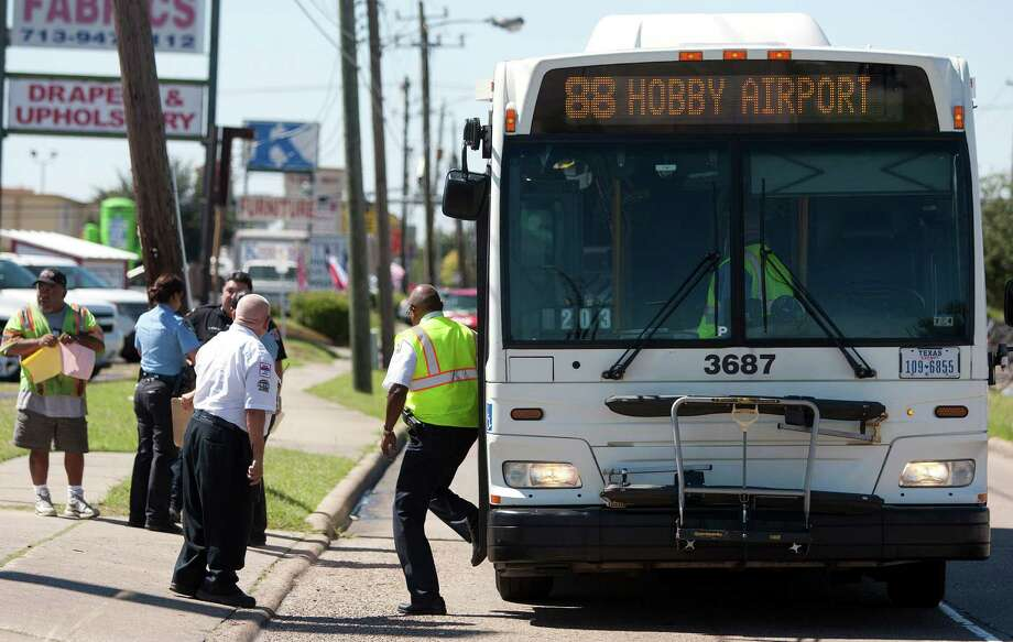 Police respond to an accident that sent seven people to the hospital, four of whom were riding a bus at about 1:10 p.m. on Almeda Genoa at Rowlett, on the No. 88 bus route Tuesday, Oct. 8, 2013, in Houston. 