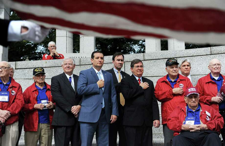Senator Ted Cruz (R-TX) (center), flanked by Texas Congressmen including Joe Barton (left), meet with WWII veterans at the WWII Memorial in Washington, D.C., October 8, 2013. Photo: Olivier Douliery, McClatchy-Tribune News Service / Abaca Press