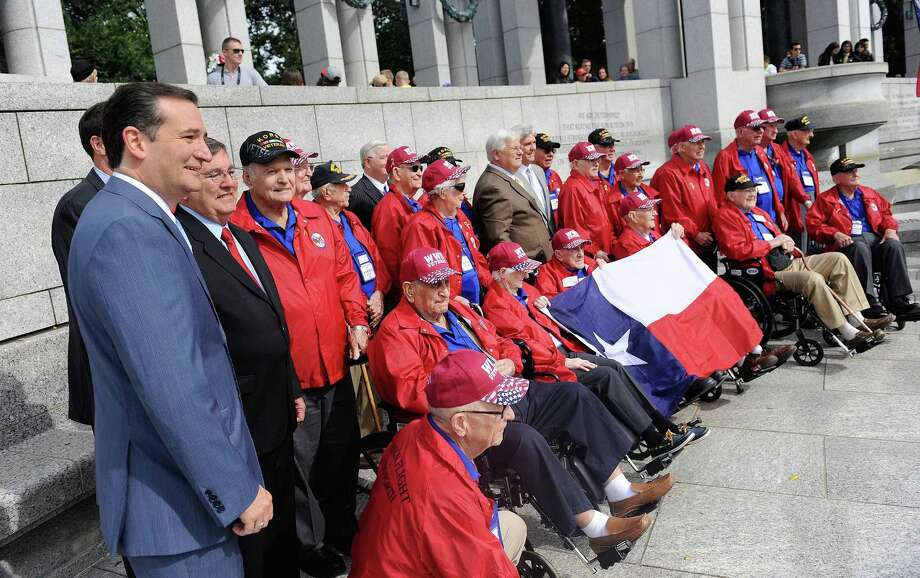 Senator Ted Cruz (R-TX) meets with WWII veterans from Texas as they visit the WWII Memorial in Washington, DC, October 8, 2013. Photo: Olivier Douliery, McClatchy-Tribune News Service / Abaca Press