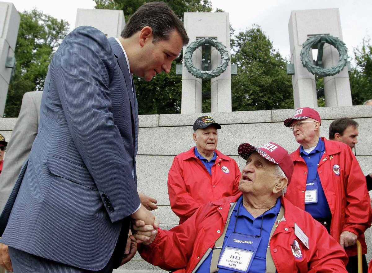 Sen. Ted Cruz, R-Texas, talks to U.S. Army World War II veteran Ivey Valentine of Texas, during a visit to the World War II Memorial in Washington, Tuesday, Oct. 8, 2013.
