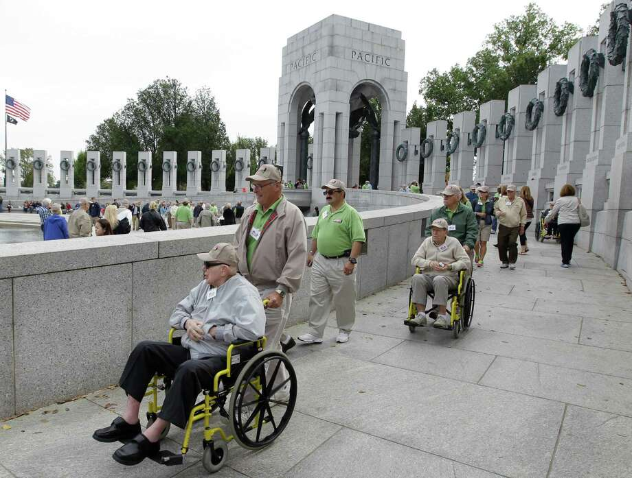 A group of World War II veterans from Florida visit the World War II Memorial in Washington, Tuesday, Oct. 8, 2013. Photo: Luis M. Alvarez, Associated Press / FR596 AP