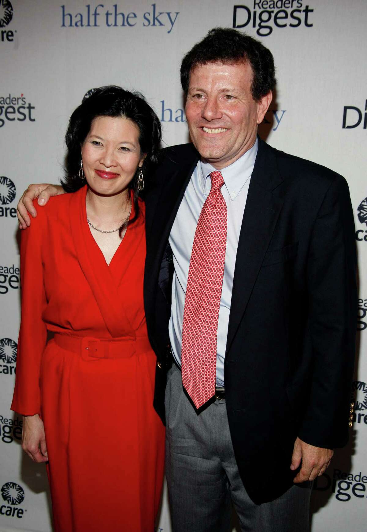 Sheryl WuDunn and Nicholas Kristof arrive at a party for the book they co-authored 'Half the Sky: Turning Oppression into Opportunity for Women Worldwide' in New York, Wednesday, Sept. 23, 2009. (AP Photo/Andy Kropa)