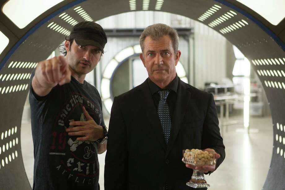 "Director Robert Rodriguez works with Mel Gibson on the set of ""Machete Kills."" Photo: Open Road Films"