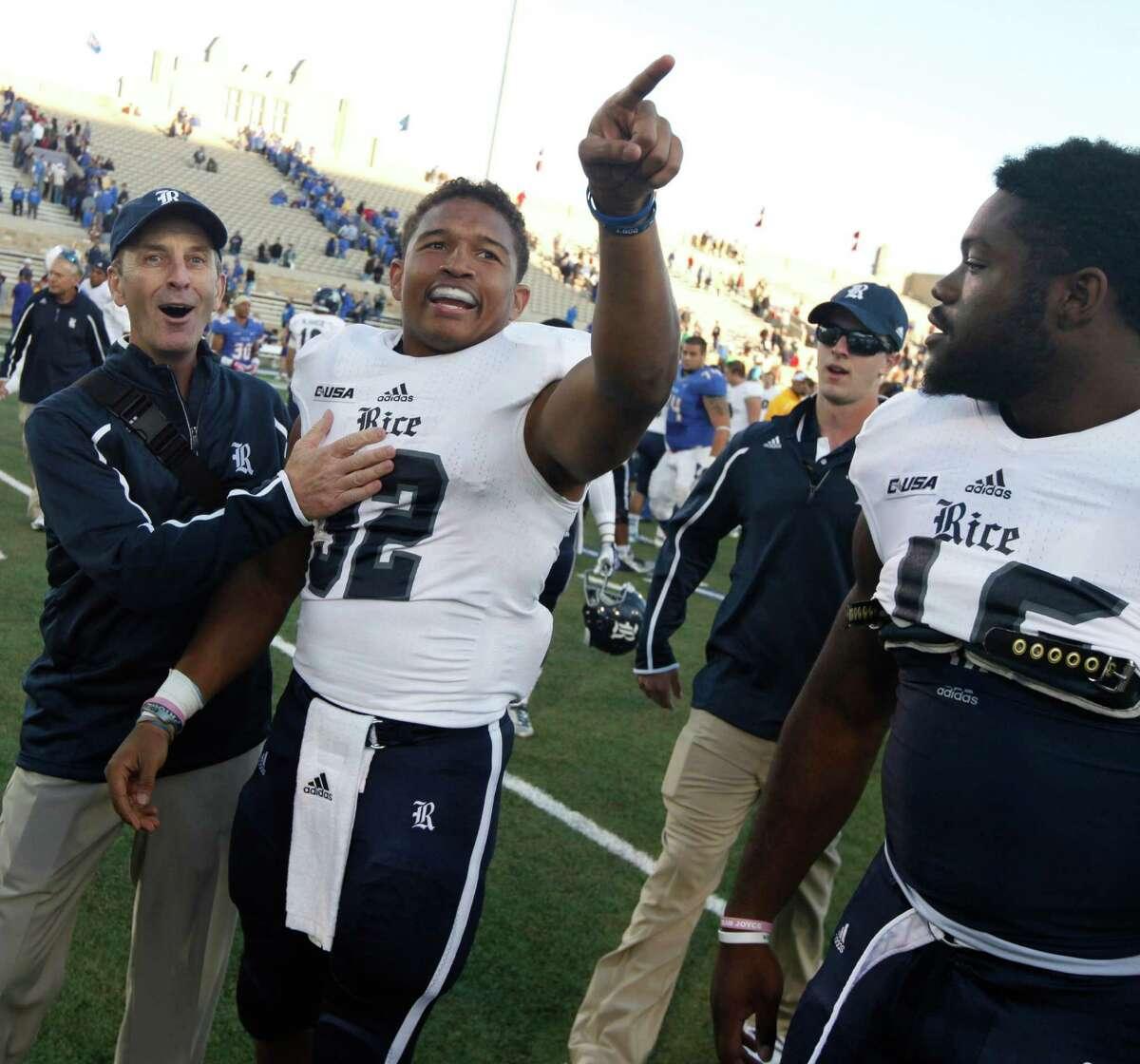 Rice's Darik Dillard, center, celebrates after he made the game winning touchdown during an overtime NCAA college football game against Tulsa, Oct. 5, 2013, at Chapman Stadium in Tulsa, Okla. (AP Photo/Tulsa World, Tom Gilbert)