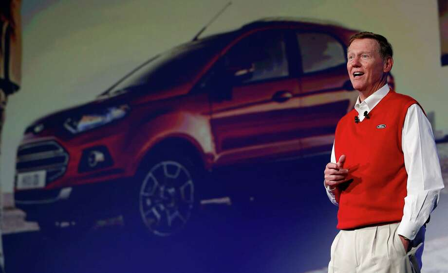 Alan Mulally, CEO of Ford, speaks in front of a picture of a Ford Ecosport car during a keynote as part of the IFA, one of the world's largest trade fairs for consumer electronics and electrical home appliances in Berlin, Germany, Friday, Sept. 6, 2013. (AP Photo/Michael Sohn) ORG XMIT: SOB119 Photo: Michael Sohn / AP