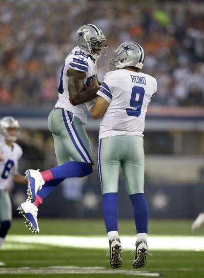 Dallas Cowboys wide receiver Dez Bryant, left, and Tony Romo (9) celebrate after Romo threw a touchd