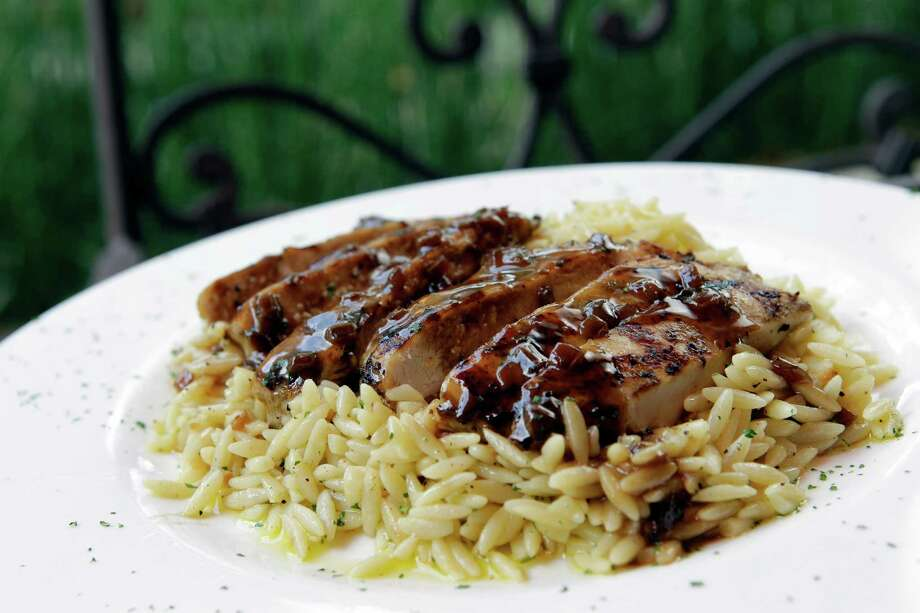 Chicken Marsala with orzo pasta is one of Carrabba's most popular dishes. It will be served at the festival. Photo: Melissa Phillip, Staff / © 2013  Houston Chronicle