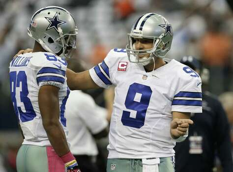 Dallas Cowboys wide receiver Terrance Williams (83) talks with quarterback Tony Romo (9) as they warm up before an NFL football game against the Denver Broncos, Sunday, Oct. 6, 2013, in Arlington, Texas. The Broncos won 51-48. (AP Photo/Tony Gutierrez) Photo: Tony Gutierrez, Associated Press / AP