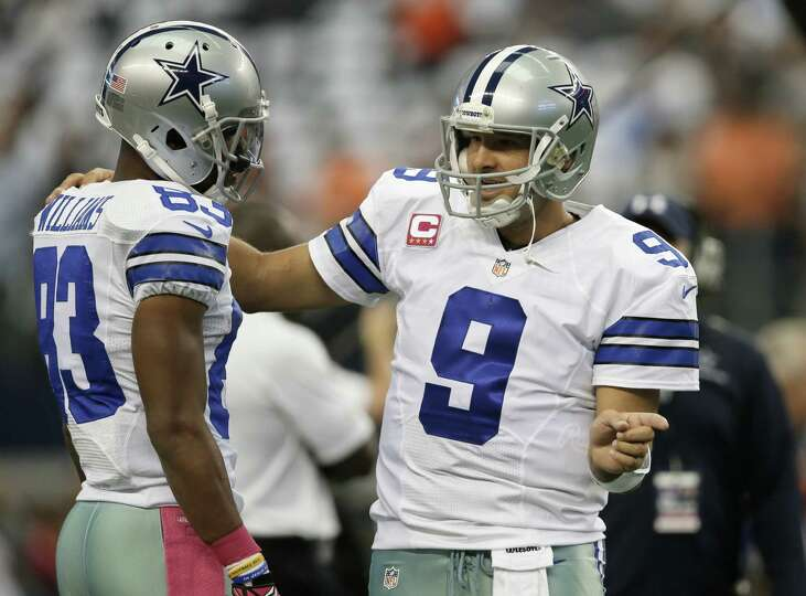 Dallas Cowboys wide receiver Terrance Williams (83) talks with quarterback Tony Romo (9) as they war