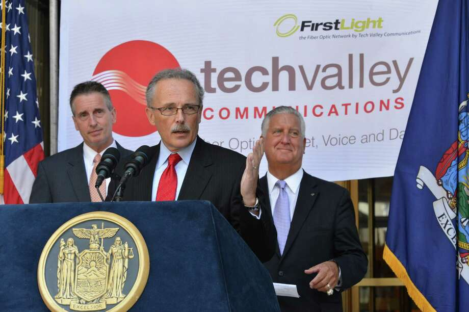 NYS Lt. Gov. Bob Duffy, left, Tech Valley Communication's CEO Kevin O'Connor and Albany Mayor Jerry Jennings, at right, announce TVC's move into new headquarters at 41 State Street in Albany Thursday Aug. 2, 2012. (John Carl D'Annibale/ Times Union) Photo: John Carl D'Annibale / 00018696A