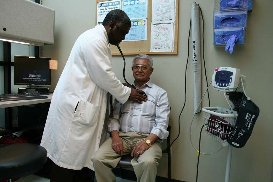 Dr. Thomas Porter checks patient Mario Gutierrez. Porter is one of the many primary care doctors at Strawberry Health Center in Pasadena.
