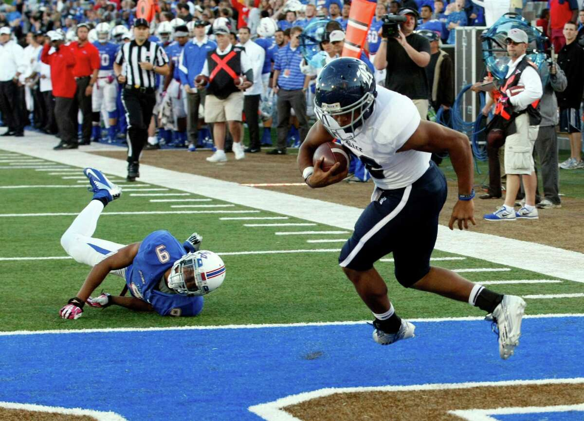 Rice's Darik Dillard, right, runs toward the end zone for the game winning touchdown during overtime as Tulsa's Dwight Dobbins, left, tries to stop him during an NCAA college football game Oct. 5, 2013, at Chapman Stadium in Tulsa, Okla. (AP Photo/Tulsa World, Tom Gilbert)
