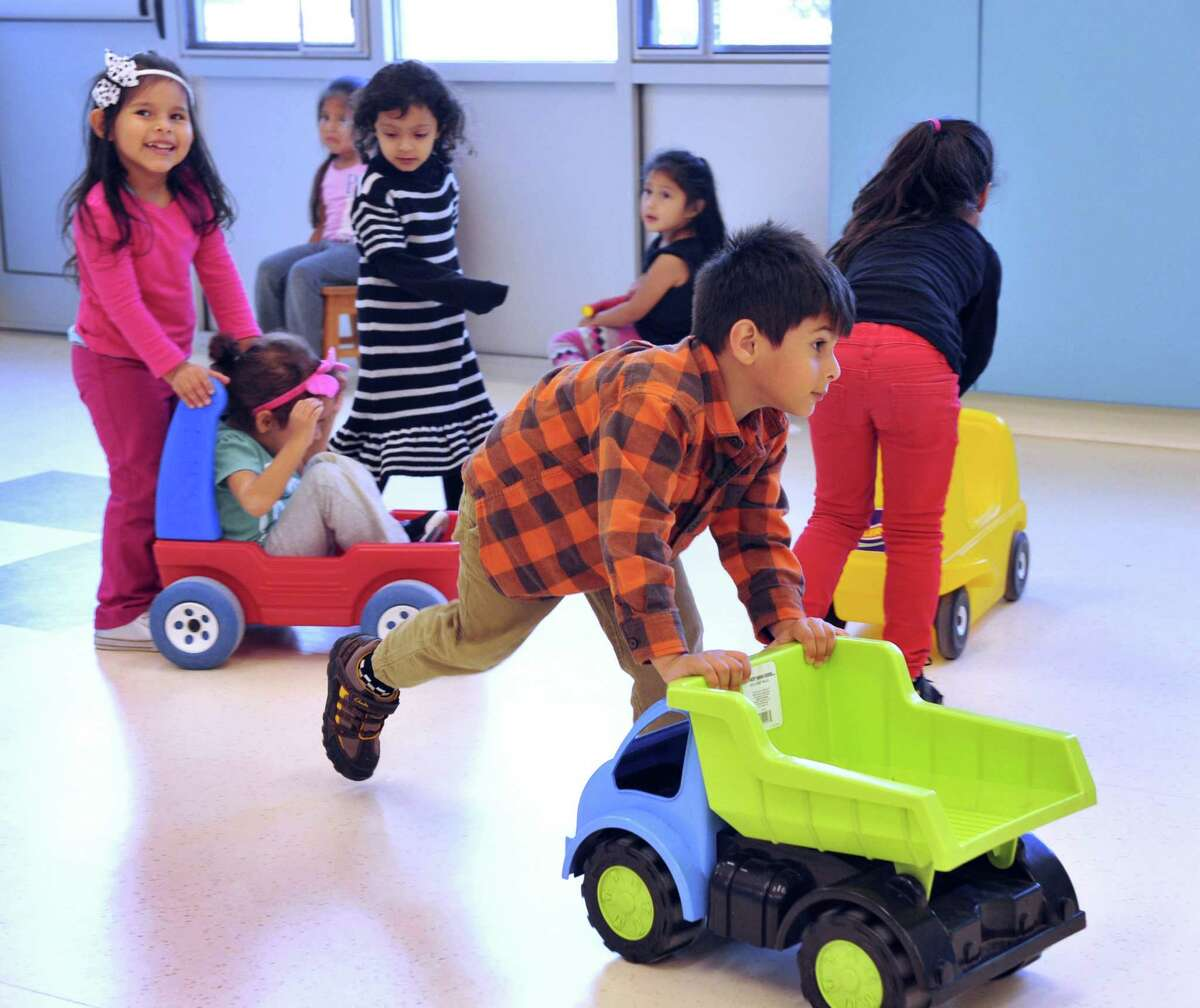 Ayaan Lateef, 3 1/2, plays with a truck in the multi-purpose room at Head Start on Foster Street in Danbury, Conn. Tuesday, Oct. 8, 2013. Head Start in Danbury is safe from the Federal government shutdown, unlike other Head Start programs in the state, because they are on a fiscal year that follows the calender, rather than the governments fiscal calender that ended on Sept. 30.
